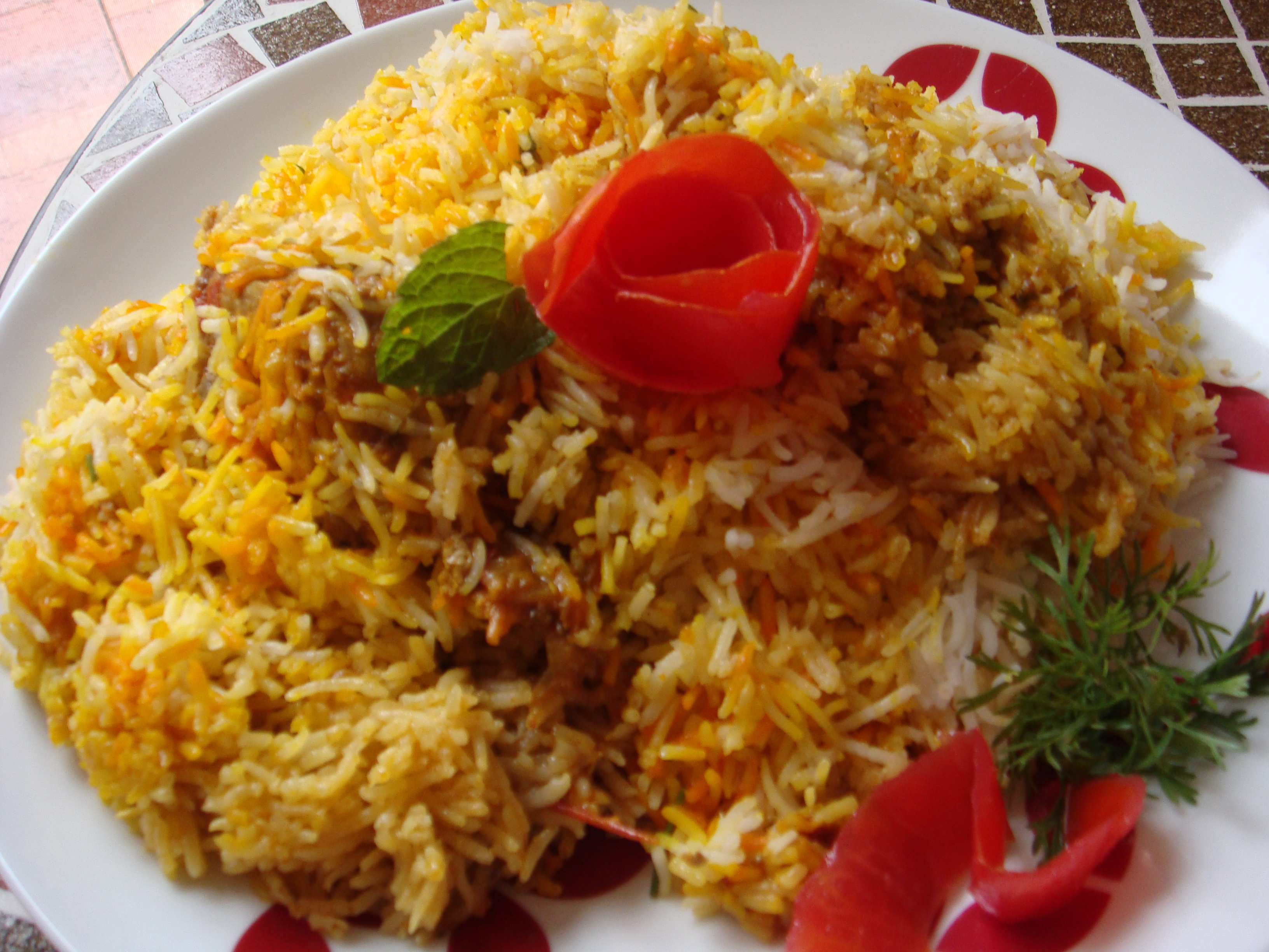 Chicken biryani in pot or pressure cooker